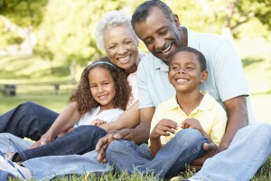 African American Grandparents With Grandchildren Relaxing In Par
