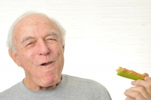 Man Is Happy Eating Celery And Peanutbutter