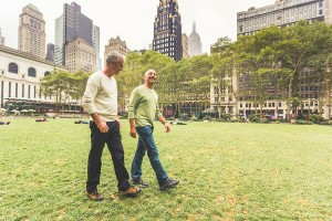 Gay Couple Walking At Park In New York